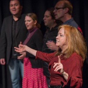 O-Lan Jones (foreground, right) directs members of the Spontaneous Combustion Choir (photo credit: Martha Benedict)